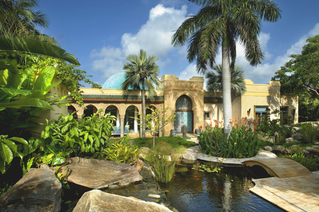Expansive ornamental grounds afford unparalleled indoor/outdoor living.