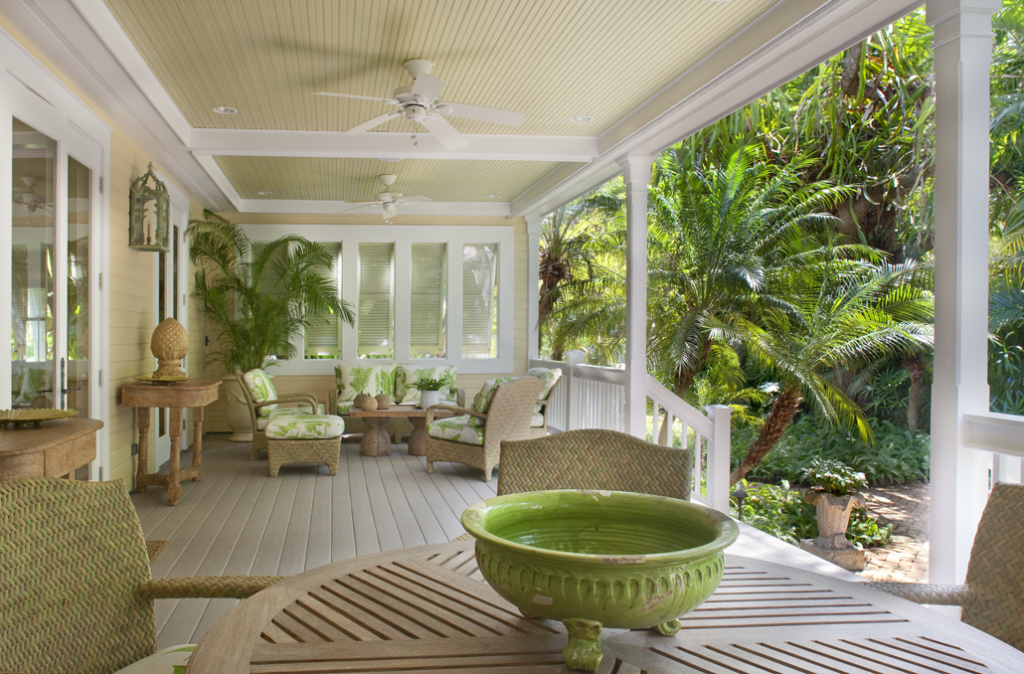 The generous front porch overlooks a secluded tropical garden.
