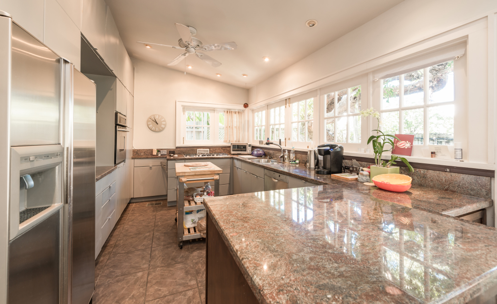 The light-filled chef's kitchen looks out to the pool and garden.