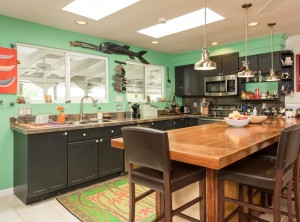 The updated kitchen overlooks the sparkling canal.