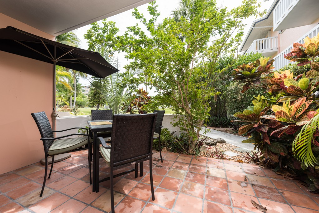 The private patio overlooks beautiful tropical gardens.