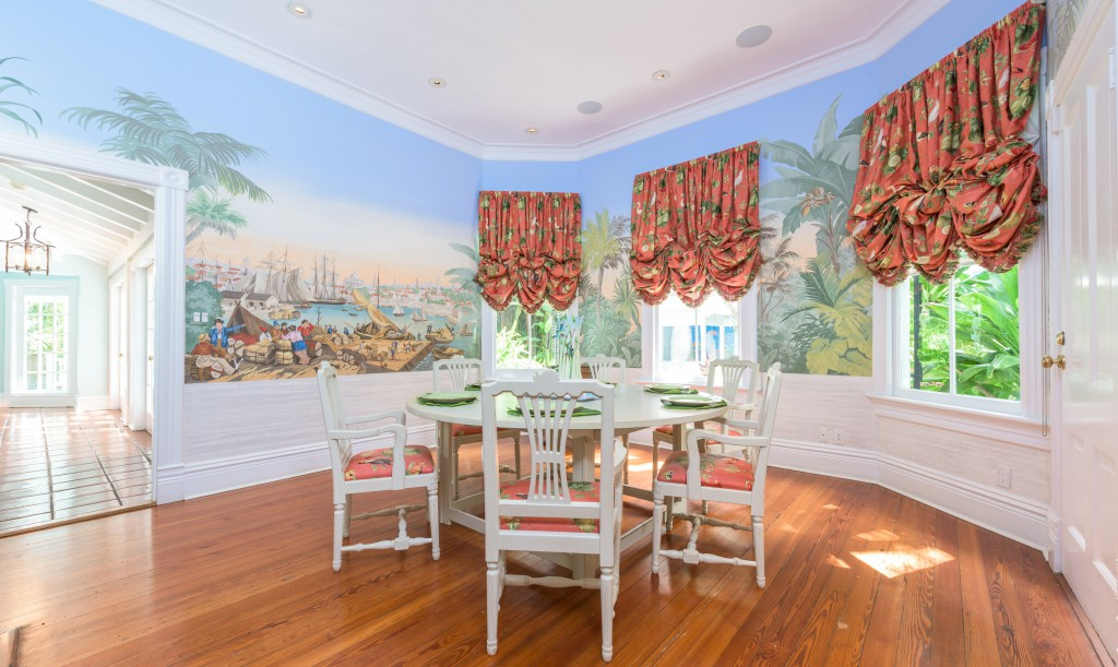 James Alan Smith's murals adorn the walls of the lovely dining room.