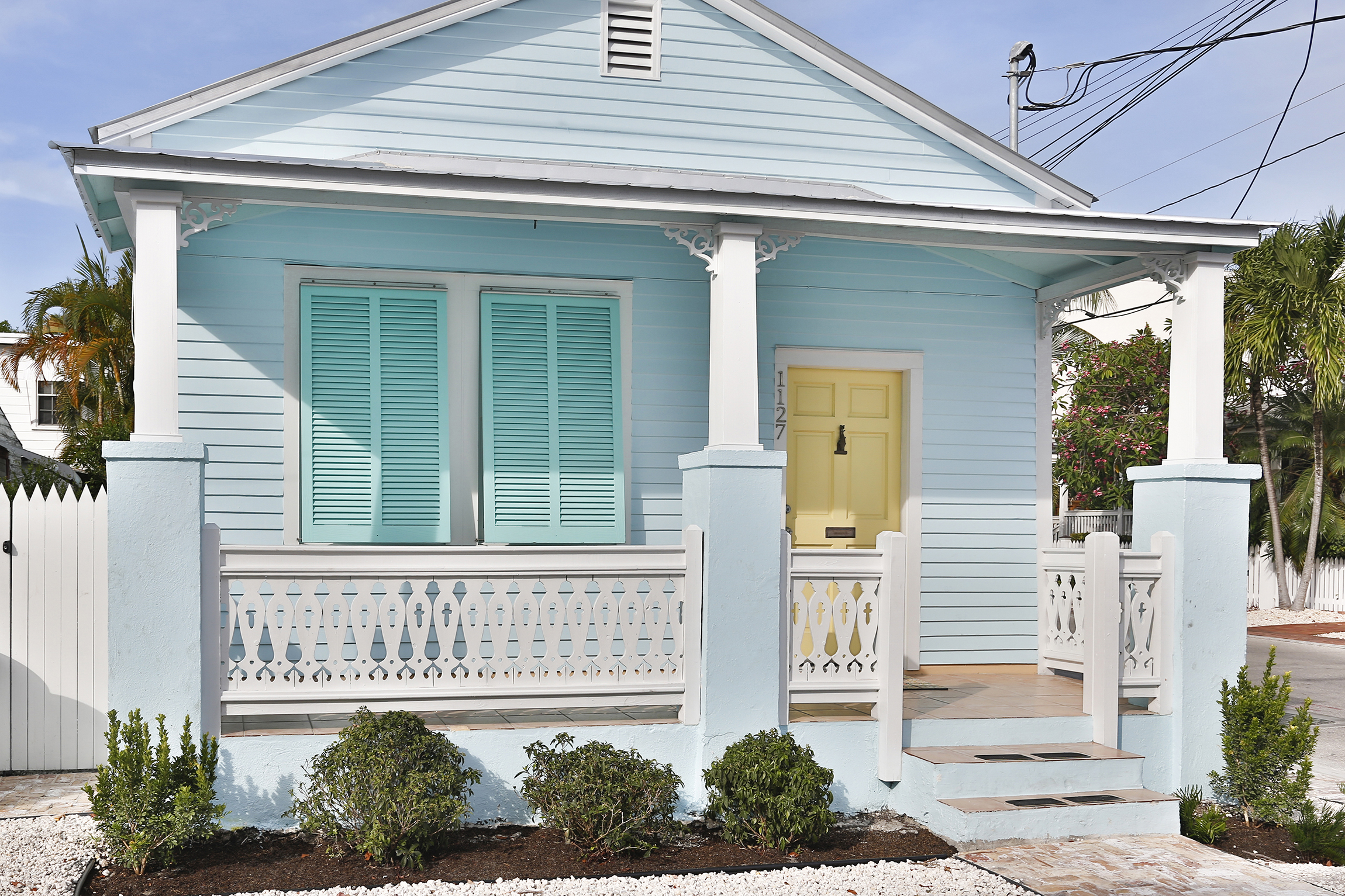 Beautifully painted in Key West colors, the quintessential conch cottage at 1127 Packer Street radiates captivating curb appeal.